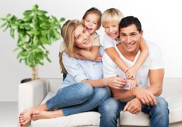 image of a couple with two kids smiling and hugging